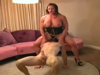 Female Bodybuilder Dominates Man And Gives Him Blowjob