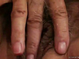 Horny busty granny masturbating
