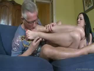 Abbie Takes Off Her Stocking And Slides Her Feet On His Cock
