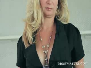 Mature Blonde undresses showing Juggs