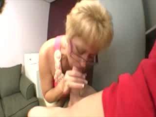 Mature granny wearing spex sucking on cock