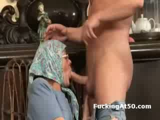Horny granny fingers herself and gives soaking wet bj