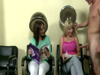 Big tit brunette jerks off a guy at the salon for a bit of fun