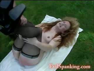 Nasty MILF spanked outdoors