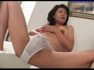 Milf masturbating on the bed jerking off young guy cock cum