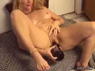 Blonde slut Annie shoves bottle in cunt