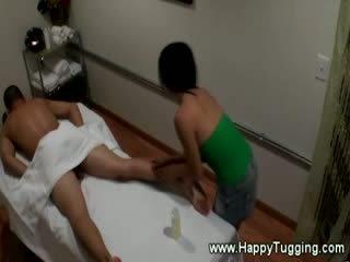 Asian masseuse pleasing customer
