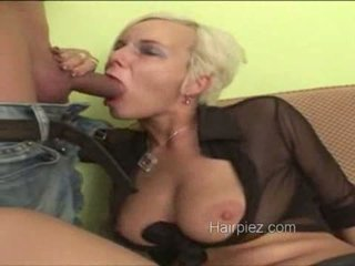 Hairy blonde rubbing and sucking on a cock