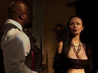 Black waiter satisfies elegant long-legged white woman.