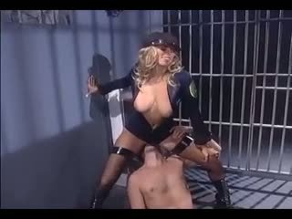 Female cop in uniform boots and stockings fucking a male inmate