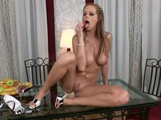 Carmen GEmini Rubbing Her Moist Crack With A Fruit WHile On The GLarse Table
