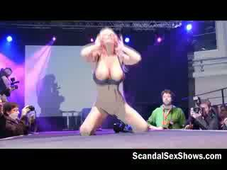 Busty blonde babe toys her pussy with a dildo for an audience