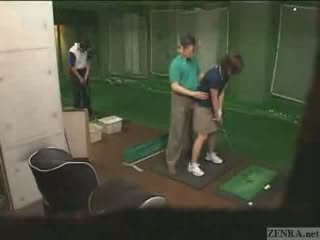 Very hands on Japanese golf lesson