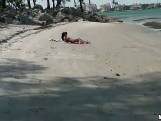 Two lusty gfs share a cock on the beach