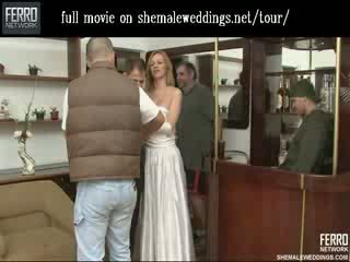 Beautiful shemale bride kissing and feeding her beefy meat to her husband