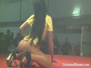 Sexy girl takes off her outfit and pleases a horny guy on the stage