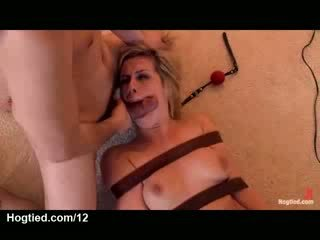 Strapped busty blonde throat fucked on the floor