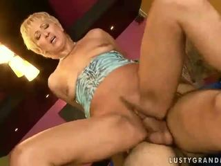 Hot granny enjoys young cock in her pussy