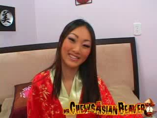 Slant eyed Asian beaver does not mind her Boobs being fondled by an unknown man