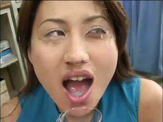 Lusty Asian chickj drinks jizz from a glass