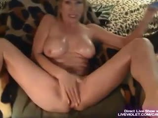 Sexy busty Milf Kat stuffing panties in her pussy