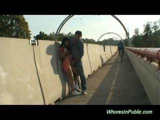 Brunette rides cock in public