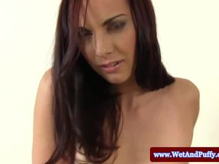 Brunette shows her puffy pussy