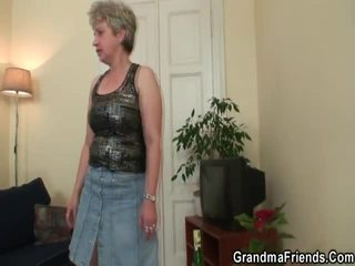 Nice Grandmother Takes Two Bananas