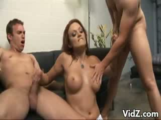Myah shows off muscles while wanking two rods