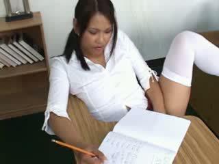 Bad asian schoolgirl fingering her tight pussy