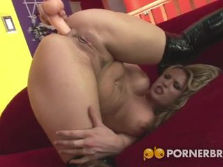 Hot blonde babe toys her asshole