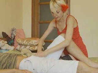 Lady in red sucking cock