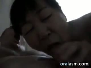 Chinese Woman Giving Head To A Big DIck