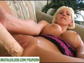 Flexible babe takes a brutal dildo real deep