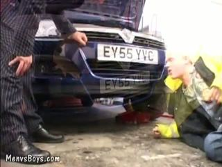 Y-ung car mechanic servicing older gay busine