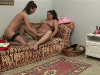 Brunette lesbians climax in oral pleasuring on the sofa
