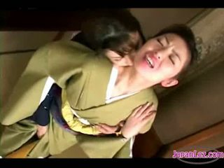 Asian girl in kimono getting her face kissed pussy and tits