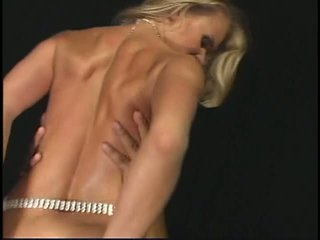 Sexy Russian-looking chick in diamond belt gets banged by two cocks in the dark