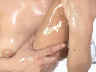 Hot oiled Asian MILF Maria enjoys petting