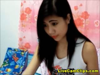 Big boobs Asian teen has a shaved pussy