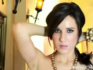 Busty brunette babe Erin Avery strips and flashes her sexy body