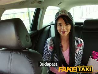 FakeTaxi Taxi driver convinces black haired hottie to suck his dick