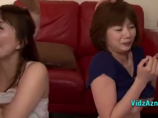 2 Asian Girls Giving Blowjobs On Their Knees Cums To Mouth On The Carpet In The Sitting Roo