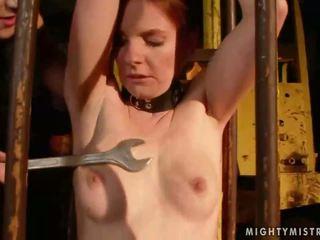 Mistress punishing sexy redhead