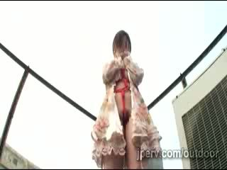 Horny jap MILF tied shibari style gets teased in rooftop