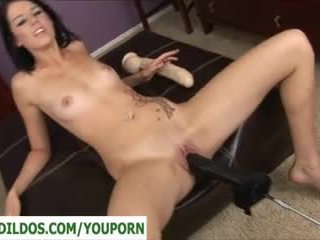 Brunette with a brutal dildo fucking m...