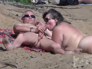 Blowjob on a nudist beach