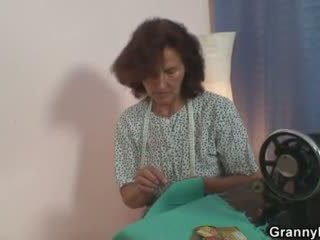Sewing granny takes her customer's coc...